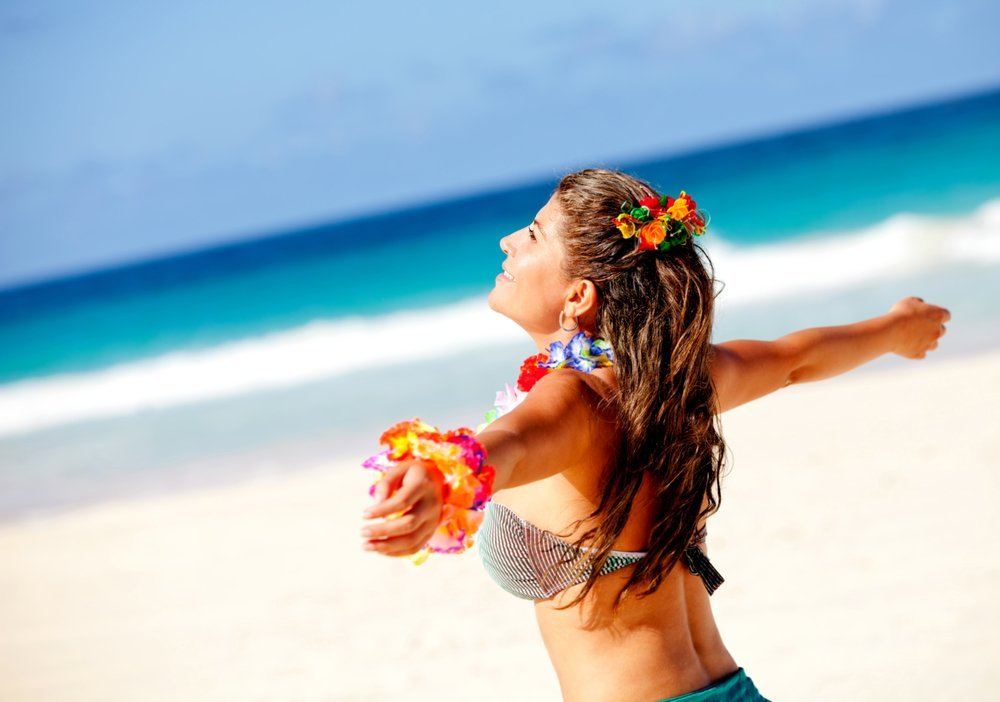 Hawaiian woman enjoying her holidays at the beach